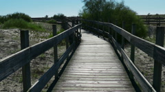 POV Walking on Wooden Walkway in the Sand Dunes Stock Footage