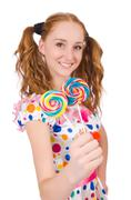 Redhead young girl with lolipops isolated on white Stock Photos