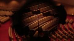 POV through rifle scope on interior auditorium  Stock Footage