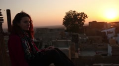 Lonely single Woman smoking at the roof top alone at sunset with depression Stock Footage