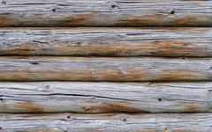 Texture of old cracked log wall - stock photo