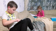 Caucasian kids spending free time in living room with calm exercises Stock Footage