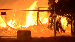 Huge fire shot in front of a wire fence  intense heat Stock Footage