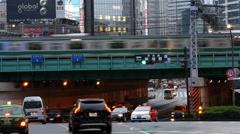 Passenger Train with Busy Street Traffic in Shinjuku - Tokyo Japan Stock Footage