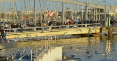 BARCELONA, SPAIN: Port Vell in Barcelona during sunset time. Stock Footage