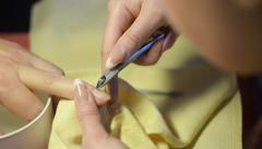 A woman gets her nails trimmed and cleaned Stock Footage
