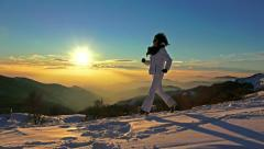 4k runner girl running downhill exercise. winter snow sunset mountain top,  r Stock Footage
