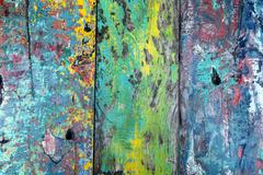 Aged and colorful grunge texture of shabby paint on a wooden surface - stock photo