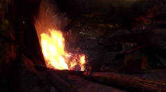 Very Hot flame in a small furnace blacksmith heats the metal before forging Stock Footage
