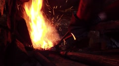 Very Hot flame in a small furnace blacksmith heats the metal before forging - stock footage