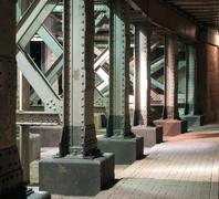 Amsterdam The Netherlands Metal rivetted pillars below a bridge Stock Photos