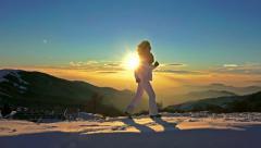 4k runner girl running uphill exercise. winter snow sunset mountain top, recr Stock Footage
