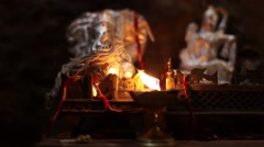 Holy Lamp during the worship of monkey god at Mahavir temple Stock Footage