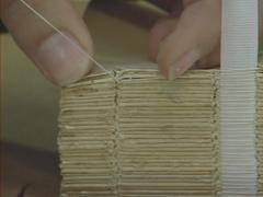 Bookbinder at work, stitching the spine of an ancient book - close up Stock Footage