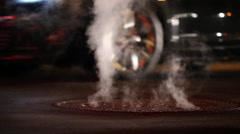 Billowing steam from sewer on late night Boston city street Stock Footage
