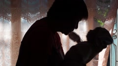 Kissing infant silhouette - stock footage