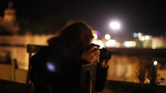 Woman checking camera at the rooftop of a indian castle fort Stock Footage