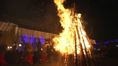 Night Festival mummers a huge fire in slow motion Stock Footage