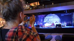 Woman at Concert Shooting Video or Photo with Smartphone Stock Footage