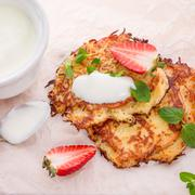 Stock Photo of potato pancakes with apfel and strawberry
