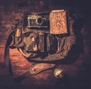 Vintage camera and handbag on wooden background Stock Photos