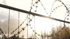 SLOWMOTION Military Fence With Backlight Stock Footage