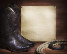 cowboy background with western shoes and lasso and paper - stock photo