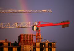 Construction crane and rainbow Stock Photos