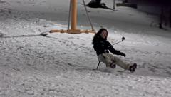 4k Kid sledding on night winter, girl run and fall down on snow. UHD stock vi - stock footage