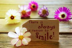 Sunny Label Life Quote There Is Always A Reason To Smile With Cosmea Blossoms - stock photo