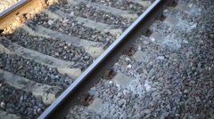 Railroad on gravel. View from window of moving passenger train Stock Footage