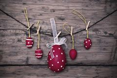 Many Red Easter Eggs And One Big Egg Hanging On Line Frame - stock photo