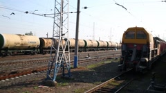 Freight train and repair train of RZD company travels Stock Footage