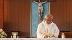 Priest opens bible - stock footage