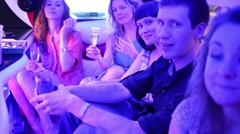 People drink wine in limousine in Moscow, Russia Stock Footage