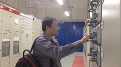 Engineer in electrical substation Stock Footage