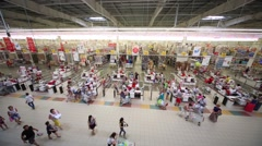 Shoppers at checkout lane Auchan hypermarket. Stock Footage
