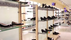 Empty big modern shop with many pairs of shoes on shelves. Stock Footage