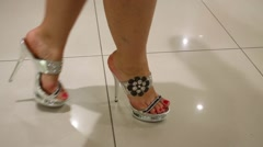 Legs of young woman in shining shoes with high heels Stock Footage