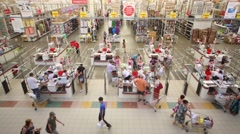 People at checkout lane Auchan hypermarket in Samara, Russia Stock Footage