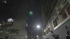 Night - low angle Taipei street - many scooters Stock Footage
