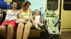 Two women and little cute boy travel in subway train Stock Footage