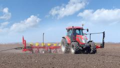Tractor seeding on a field - stock footage