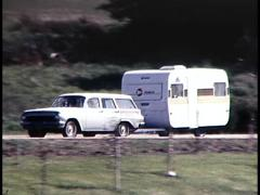 Stock Video Footage of CARAVANS TRAVELLING DOWN ROADS