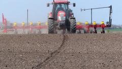 Tractor and Seeder Planting Crops - stock footage