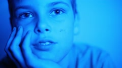 Close-up portrait of boy looking into camera in studio Stock Footage
