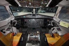 Cockpit of propeller aircraft at the airport Stock Photos