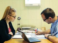 Male doctor writing rx prescription and talking with patient in the office NTSC Stock Footage