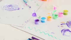 Children creativity on table with paints, brushes and pencils Stock Footage