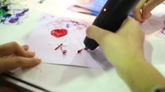 Children hand writing with red plastic ink by modern device Stock Footage